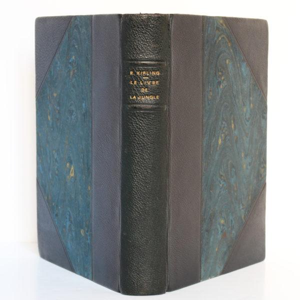 Le Livre de la jungle, Rudyard KIPLING. Illustrations H.DELUERMOZ. Librairie Delagrave, 1936. Reliure : dos et plats.